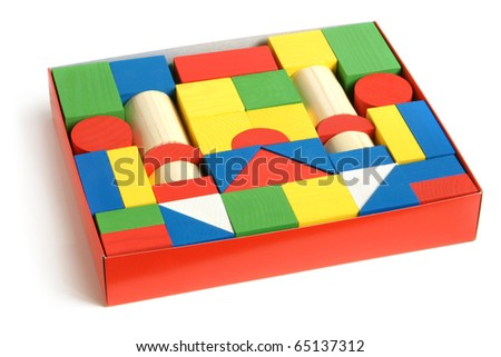 Wooden building blocks in box on a white background - stock photo