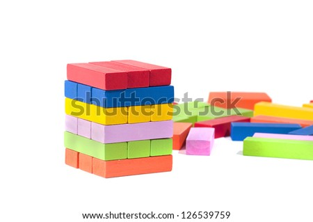 wooden building blocks, in many colors, isolated on white background - stock photo