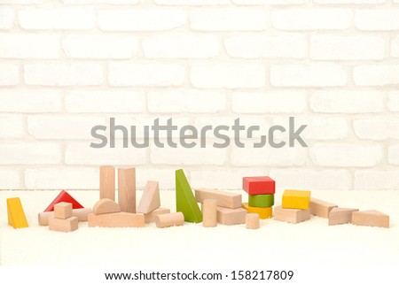 Wooden building blocks in playing room for babies - stock photo