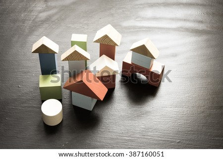 Wooden building blocks on a black/toned photo - stock photo