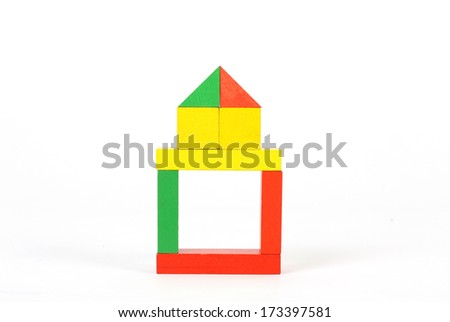 Wooden building blocks on white background - stock photo