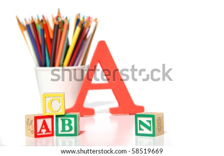 Wooden building blocks with pencils on white - stock photo