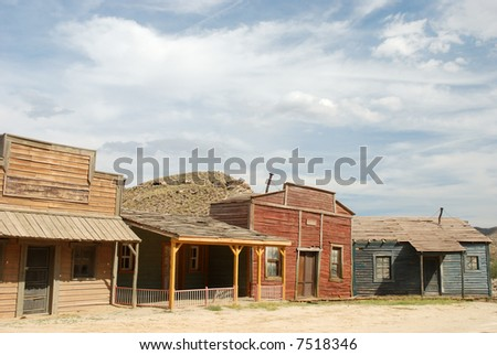 Wooden buildings in an old American western town - stock photo