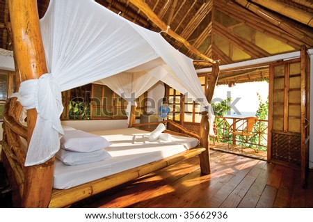 Wooden Bungalow with Perfect Tropical Seaview - stock photo