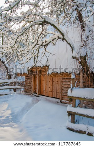 Wooden cabin in a winter park