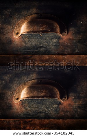 Wooden cabinet drawers with metal handle close up, old rustic storage furniture - stock photo