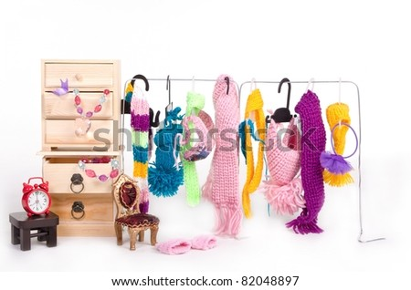 Wooden cabinet with clothes and accessorys for tiny dog - stock photo