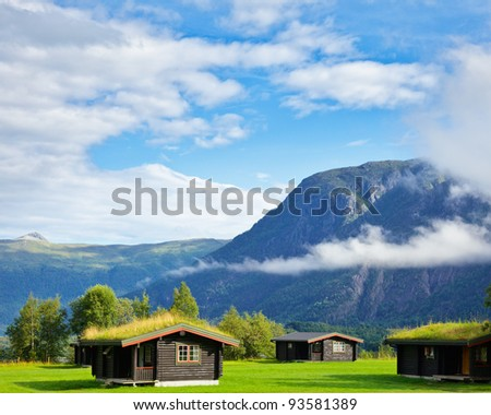 Wooden cabins with turf roof at a campsite in Norway - stock photo