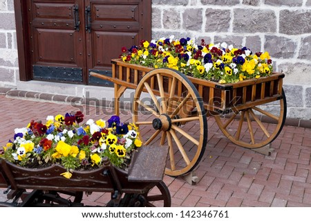 Wooden cart inside the flowers in capital ankara turkey - stock photo