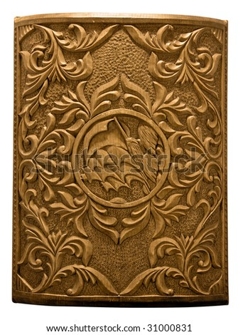 Wooden carved cover of chest with beautiful pattern - stock photo