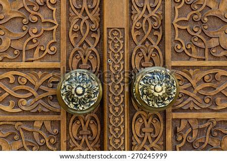 Wooden carved door - stock photo