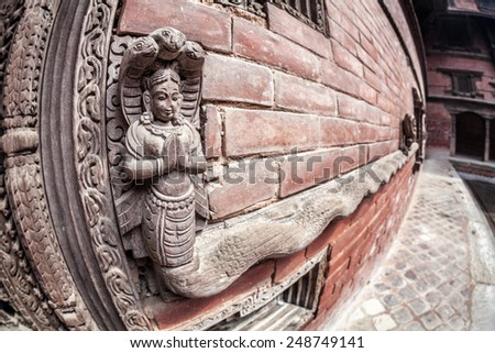 Wooden carved snake Goddess at king palace museum on Durbar square in Kathmandu, Nepal - stock photo