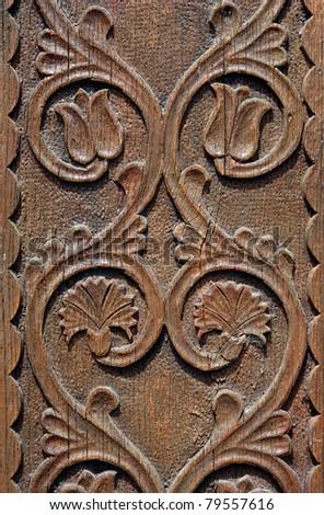 wooden carving gate in transylvania - stock photo