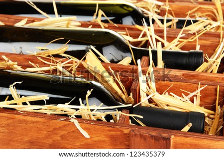 Wooden case with wine bottles close up - stock photo