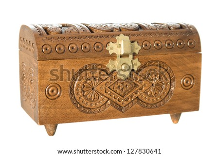 Wooden casket decorated with carvings isolated on white background - stock photo