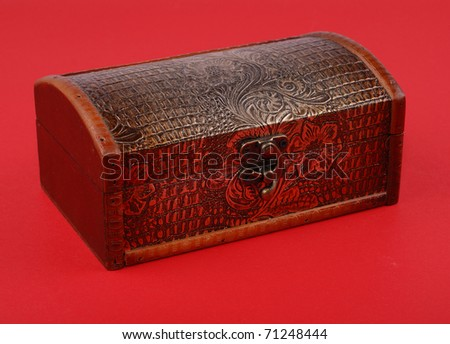 wooden casket on red background. - stock photo