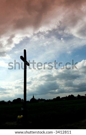 Wooden  catholic cross   on a sky background - stock photo