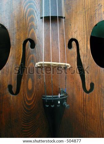 Wooden cello with shadows - stock photo