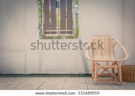 wooden chair and bin at outdoor in vintage style