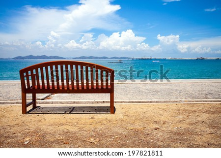 wooden chair at the tropical sand beach - stock photo