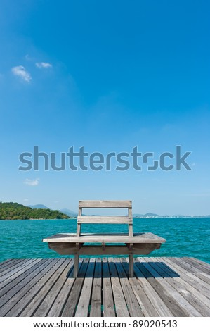 Wooden chair at  wooden pier in the sea, Thailand