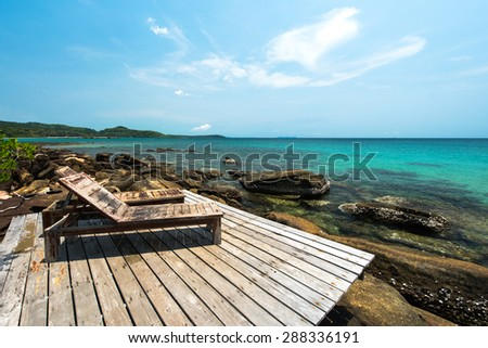 Wooden chair for relaxation at the beach