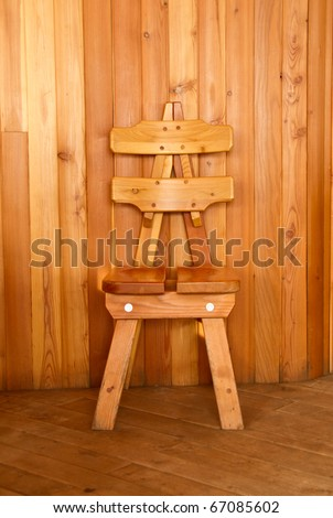 Wooden chair in front of a wood tiled wall