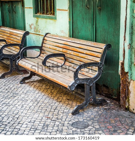 Wooden Chair in Grungy Abandoned Place - stock photo