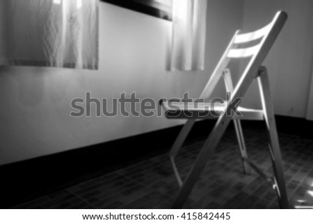 wooden chair in room near window,black and white tone blurred