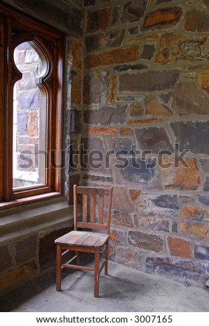 Wooden Chair on Stone Porch - stock photo