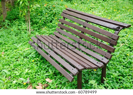Wooden chair standing in nature - stock photo