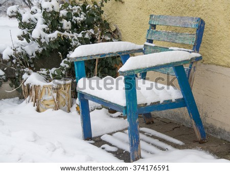 wooden chair under the snow - stock photo