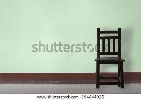 Wooden Chair vintage  in front wall - stock photo