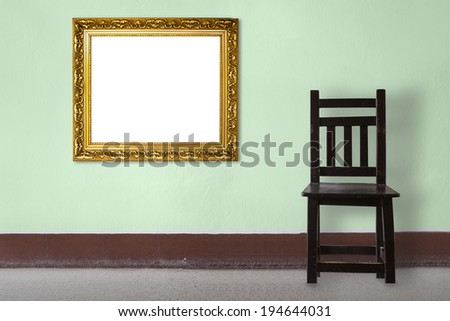 Wooden Chair vintage with frame  in front wall - stock photo