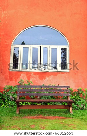 wooden chair with windows on Italian style building - stock photo