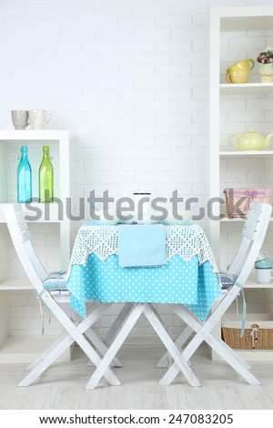Wooden chairs and table in cozy kitchen - stock photo