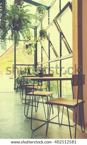 wooden chairs and table in terrace in coffee shop