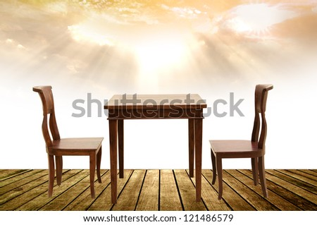 wooden chairs and table on wooden floor - stock photo