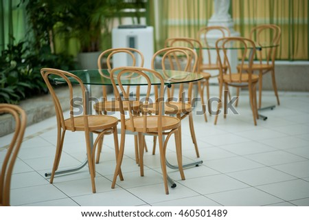 Wooden chairs at a table in a cafe
