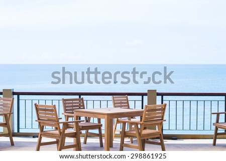 wooden chairs for relax outdoor on the beach and sea