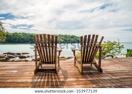 Wooden chairs in beautiful tropical island rock beach - Koh Kood, Trat Thailand - stock photo