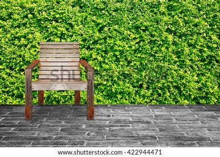 wooden chairs in garden. - stock photo
