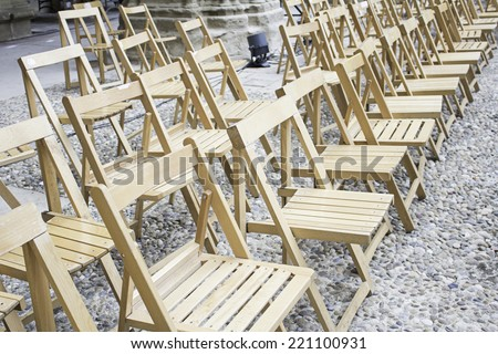 Wooden chairs in street event, celebration - stock photo