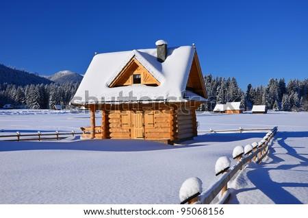 Wooden chalet in winter in Zakopane - Tatra Mountains - stock photo