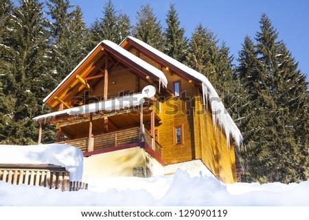 Wooden chalet in winter mountain in Carpathians - stock photo