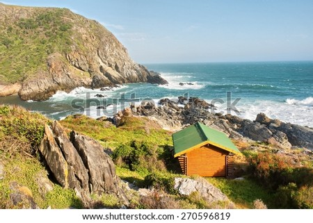 Wooden chalet on sea shore. Shot on the Otter trail in the Tsitsikamma National Park, Garden Route area, Western Cape, South Africa.  - stock photo