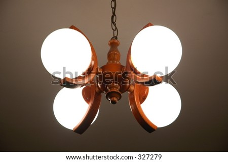 wooden chandelier with 4 lamps - stock photo