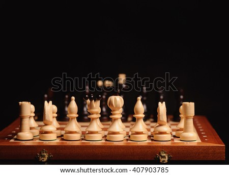 wooden chess pieces with chess desk