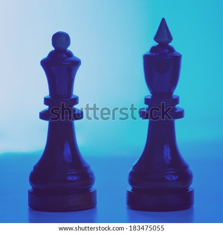 Wooden chessmen. King and queen chess pieces. Filtered image - stock photo