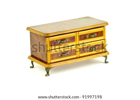 Wooden chest of drawers on white background - stock photo